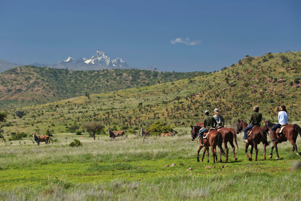 Riding Wild safari with Mount Kenya in the background.