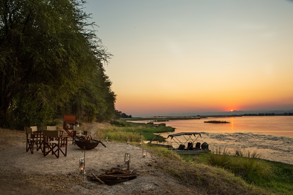 Sundowners in wild dog country in Mana Pools, Greater Mana Expeditions