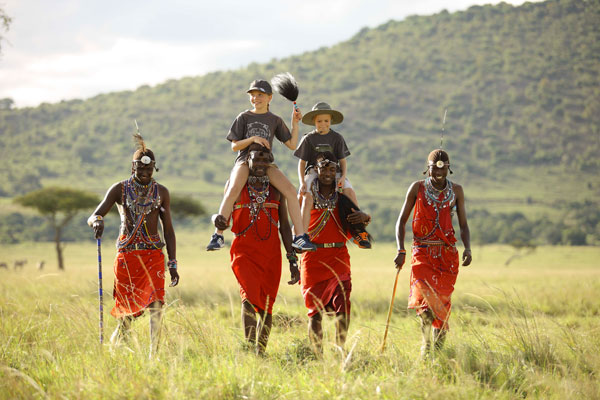 Kichwa Tembo guides walking with children,