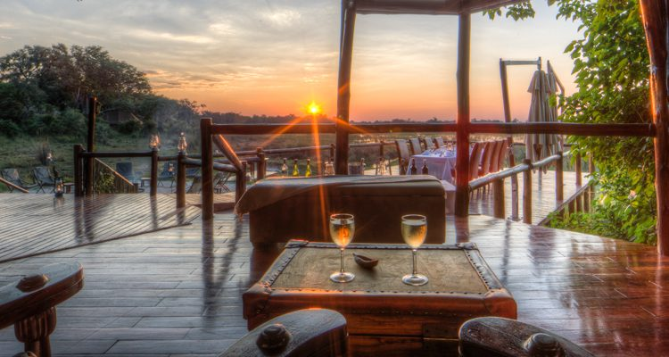 safari camps luxury - Sundowners at Kanana Camp, Botswana