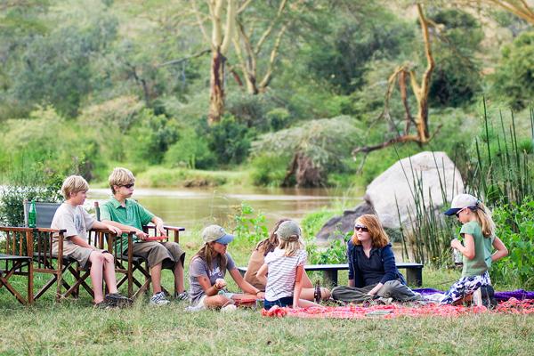 Family picnic by the river at Sosian, Laikipia, Kenya