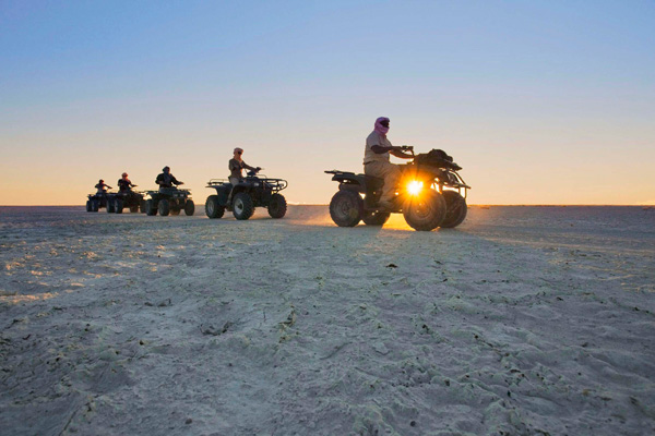 Quad-biking across the pans at Jack's Camp