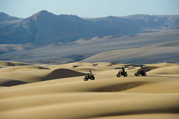 Quad biking in the dunes from Serra Cafema Camp