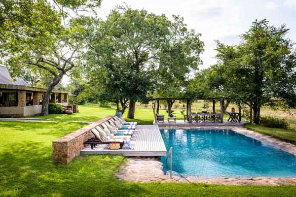 Relaxing around the pool at Singita Castleton, South Africa