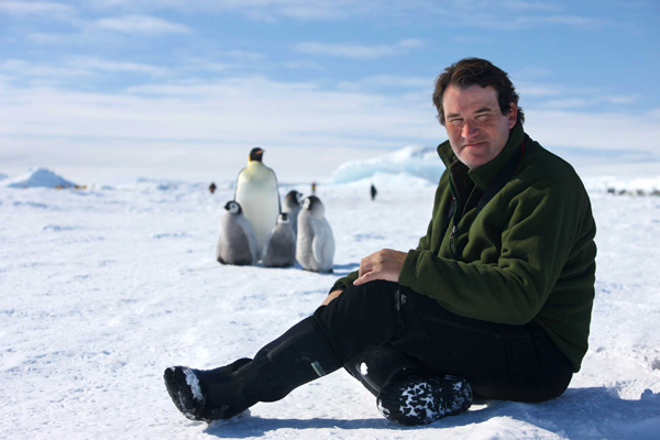 Alastair Fothergill in Antarctica with king penguins - credit Sue Flood