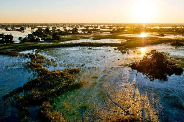 Okavango Delta sunrise, Pelo Camp, Botswana credit Wilderness Safaris Dana Allen