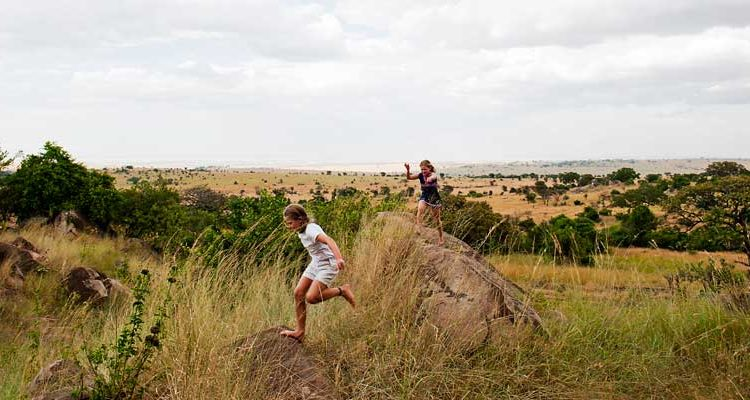 Nomad Lamai Serengeti children playing on rocks - October half term holiday in Tanzania