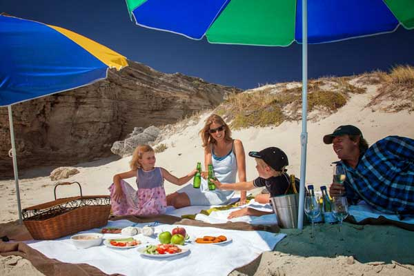 Family picnic on a Garden Route beach, Grootbos