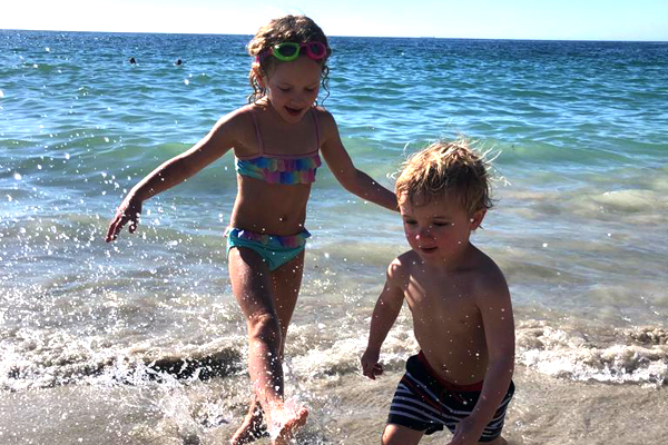 Bella and George playing on the beach, credit Rosanna Pile