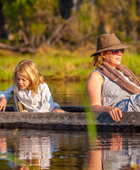 Family safaris Botswana - mother and daughter in a mokoro in the Okavango Delta
