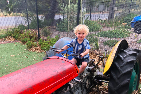 George on a tractor at the children's play area at Noordhoek Farm Village