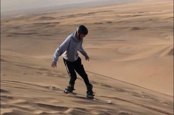 Sandboarding in the dunes near Swakopmund