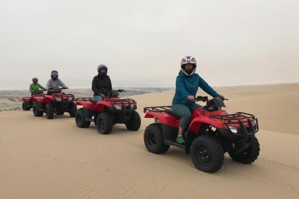 Exploring the dunes on quadbikes Namibia family safari