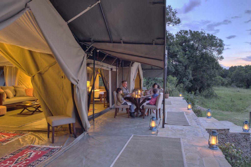 Kenyan family safari - at dinner at safari camp Kicheche Mara, Kenya