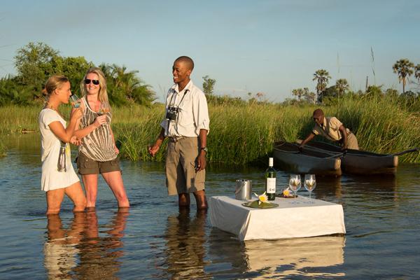 Sundowners on a mokoro trip at Xigera Camp