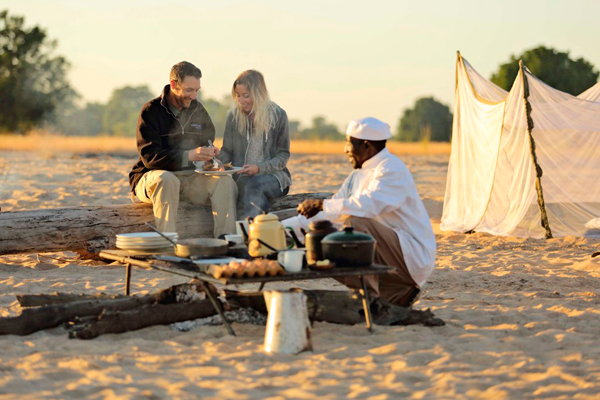 Norman Carr Safaris, camp cooking, in Zambia. Time + Tide Africa