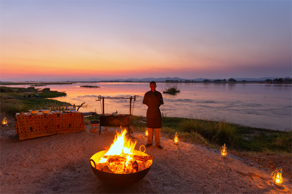 Sundowners and camp fire by the river, Mana Pools, Zimbabwe, Sapi Explorers