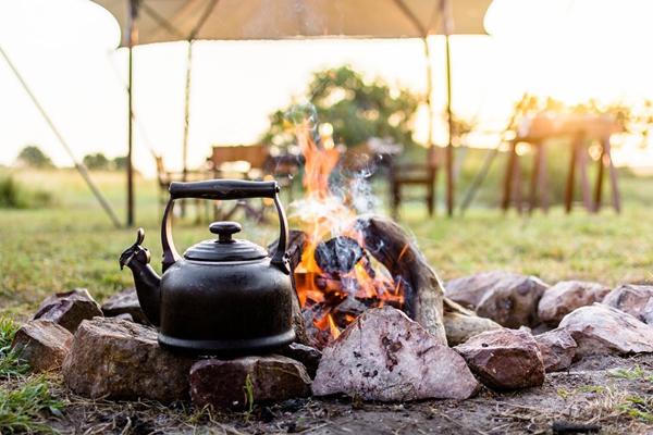 Camp fire morning tea, Singita Explore, Tanzania