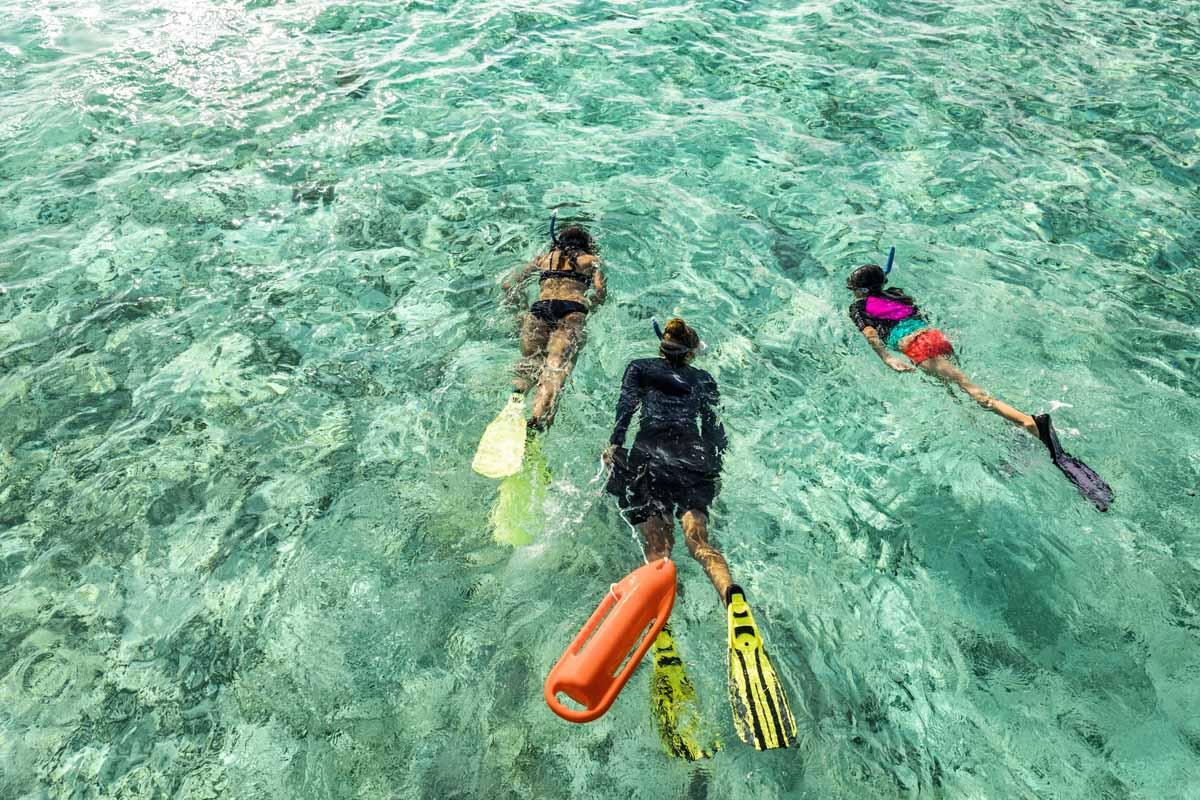 Como Cocoa Island snorkeling family, Maldives