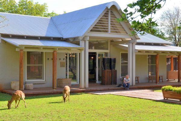 Bushbuck feeding on the front lawn at Morukuru Farmhouse