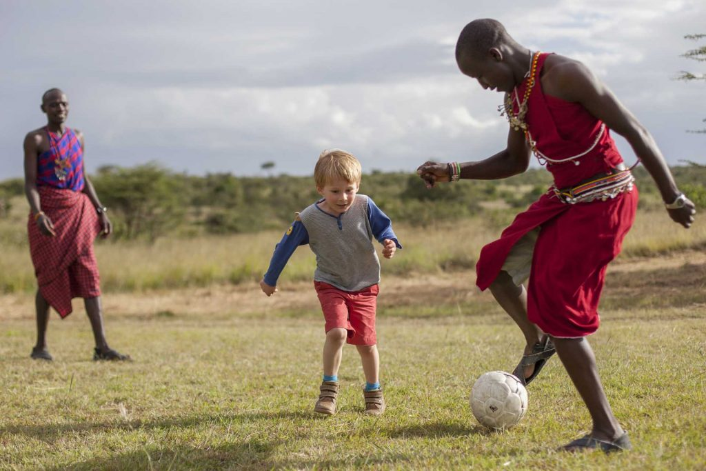 active family safaris. Football with the guides at Encounter Mara Camp, Masai Mara, Kenya