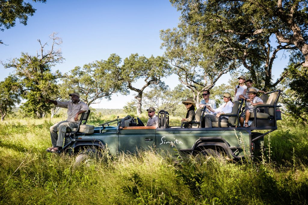 Enjoying a family wildlife drive, Singita Boulders Lodge, Sabi Sand, South Africa
