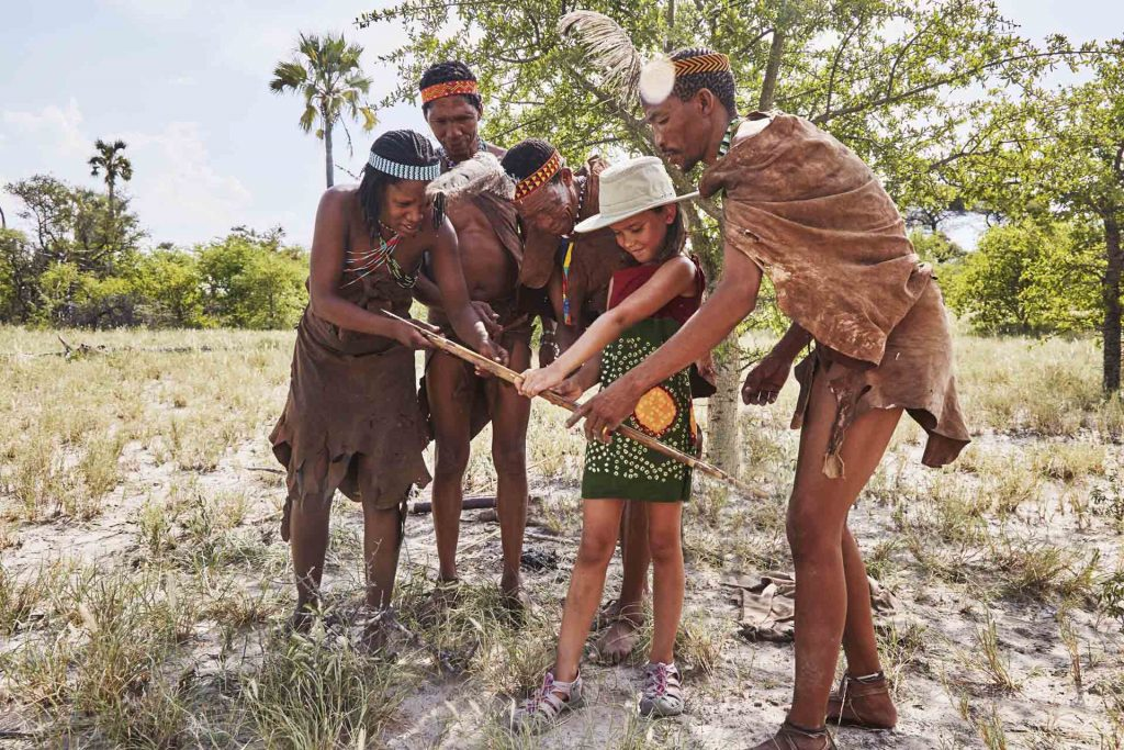 Learning local customs from the San Bushmen, Camp Kalahari, Makgadikgadi Pans, Botswana
