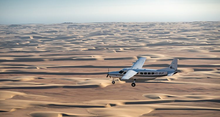 Luggage allowance for safari planes - flight over Namibian dunes