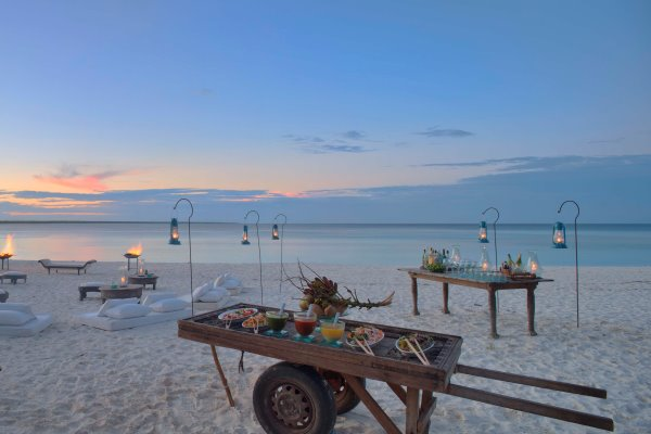 Sundowners on the beach at Mnemba Island